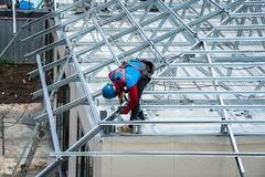 Workers are building a steel roof frame on high. Royalty Free Stock Photos