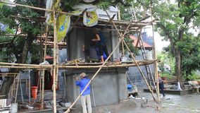 Workers building the temple worship stock video