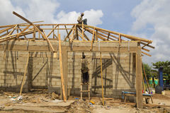 Workers building a wooden house in Nigeria, Africa Royalty Free Stock Images
