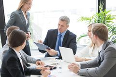 Workers at business meeting stock images