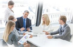 Workers at business meeting stock photo
