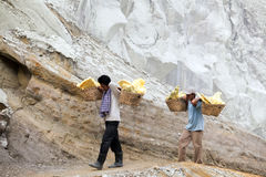 Workers carry sulphur Royalty Free Stock Photography