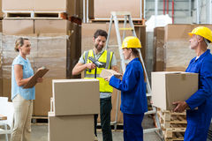 Workers carrying boxes Stock Image
