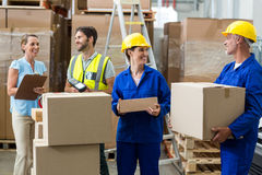 Workers carrying boxes Royalty Free Stock Photography
