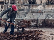Carrying truck load of soil. Workers carrying truck load of soil Stock Image