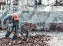 Carrying truck load of soil. Workers carrying truck load of soil Royalty Free Stock Photos