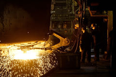 Workers cater for equipment. In the steel producing workshop royalty free stock photo
