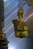 Workers cater for equipment. In the steel producing workshop stock images