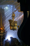 Workers cater for equipment. In the steel producing workshop stock photos