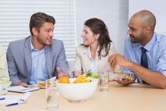 Workers chatting while enjoying healthy lunch. In the office royalty free stock images