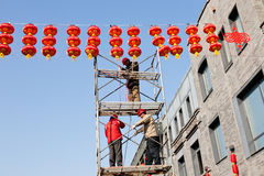 Workers checking red lanterns Royalty Free Stock Photography
