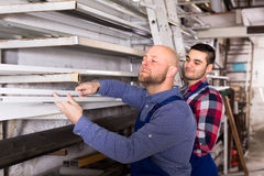 Workers choosing PVC window profile Royalty Free Stock Photo