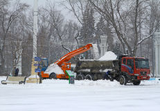 Workers clean from the road snow in VDNKh in Moscow Stock Photo