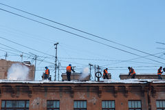 Workers clean the roof from snow Royalty Free Stock Photo