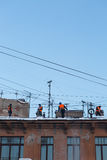 Workers clean the roof from snow Stock Image