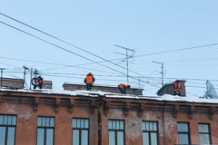 Workers clean the roof from snow Stock Photo