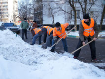 Workers clean snow Royalty Free Stock Photography