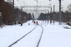Workers cleaned the railroad after a heavy snowfall. Stock Photo