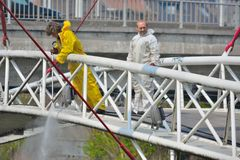 Workers cleaning a bridge with a high pression machine. BELGIUM, GHENT, 23 April 2015: Unidentified Workers cleaning a bridge with a high pression machine Royalty Free Stock Photo