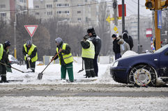 Workers cleaning city after blizzard Royalty Free Stock Image