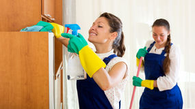 Workers of cleaning company. Cheerful young female workers cleaning company ready to start work Stock Photos
