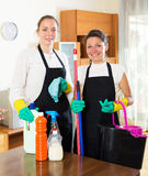 Workers of cleaning company. Positive adult female workers cleaning company ready to start work Stock Photography