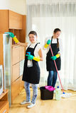 Workers of cleaning company. Smiling young women workers cleaning company ready to start work Stock Photo