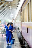 Workers are cleaning up the train. Royalty Free Stock Images