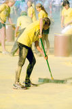 Workers cleaning up yellow powder Royalty Free Stock Photography