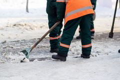 Workers cleans snow shovel Stock Images