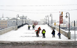 Workers clear snow-covered bridge Royalty Free Stock Images