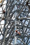 Workers  climb as work on high voltage electric post. Workers  climb as work on high voltage electric post in Bangkok Stock Images