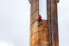 Workers climbing on the big chimney Royalty Free Stock Photo