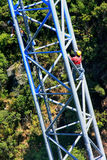 Workers climing supporting pole, Sky Bridge Royalty Free Stock Photos