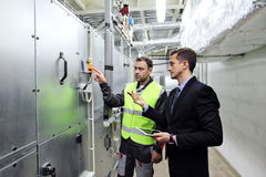 Workers at CNC plant. Worker and manager in electrical switchgear room of CNC plant Royalty Free Stock Photos