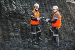Workers with coal at open pit. Two speacialists examining coal at an open pit Stock Images