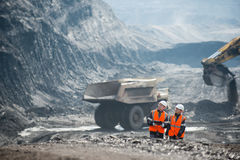 Workers with coal at open pit. Two speacialists examining coal at an open pit Royalty Free Stock Photos