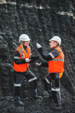 Workers with coal at open pit. Two speacialists examining coal at an open pit Royalty Free Stock Image