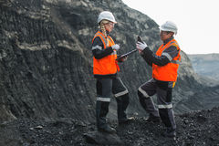 Workers with coal at open pit Royalty Free Stock Image