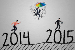 Workers compete to arrive on number 2015 Royalty Free Stock Photography
