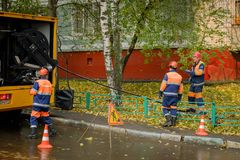 Workers conduct water pipe repair work in the street Royalty Free Stock Photos