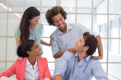 Workers congratulating and praising one another. In the office royalty free stock photo