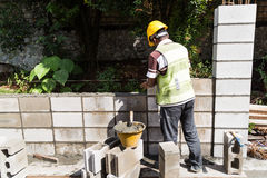 Workers constructing building noise barrier walls at busy highwa Stock Photo