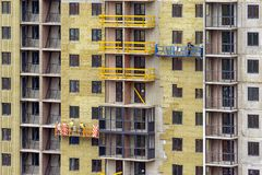 Facade work and insulation of a multistory building royalty free stock image
