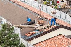 Workers in the construction of a roof. Stock Photo