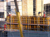 Workers at the construction site. Workers assembling elements at the construction site stock photography