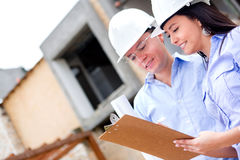 Workers in a construction site Royalty Free Stock Images