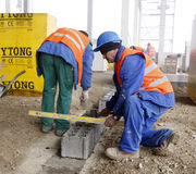 Workers on construction site. Workers working on construction site in Romania Royalty Free Stock Images