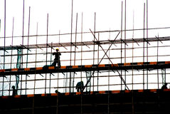 Workers and construction site Royalty Free Stock Photos