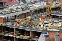 The workers at the construction site. Stock Images